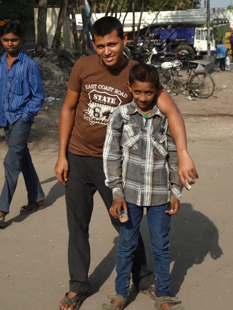 Two boys posed for me at the bus stop while I was taking pictures of autos for Ashwin