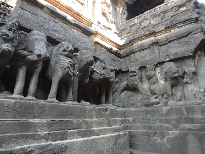 Elephants, lions and gryphons supporting the temple.